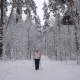 Wood. Day Winter Forest. The Elderly Woman on Walk. The  Aged Is Engaged in the Health. The Pensione Nulled