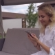 Happy Friendly Lady Using Mobile Phone. Nulled