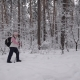 Sport Adult Woman Quickly Goes Through the Woods. Behind Her Is a Backpack Nulled