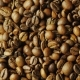 Grains of Roasted Coffee Varieties Arabica and Robusta Are Rotated Nulled