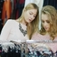 Two Young Caucasian Women Choose Things in Women's Clothing Store Nulled