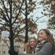 Two Young Girls Friends Do Selfi Autumn in One of the City Streets. - VideoHive Item for Sale