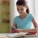 Girl with Smartphone Distracting From Homework 70