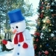 Dancing Snowman, Funny Man Dancing in Fancy Dress on the Background of the Christmas Tree Outdoors Nulled