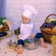 Adorable Baby Male Child in the Kitchen Cooking, Playing with Bank of Lentils
