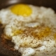 Preparing Scrambled Eggs on Hot Frying Pan