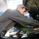 Mechanic in Overalls Working in the Garage