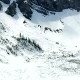 Aerial: Flying Over Frozen Lake and Avalanche Debris