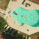 Rotating Drone Footage of Family Enjoying in Swimming Pool - VideoHive Item for Sale