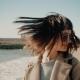 Attractive Girl Walks Near Shore Line in Small Mediterranean Town
