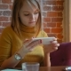 Attractive Woman in a Street Cafe Reading a Text Message From Her Phone - VideoHive Item for Sale