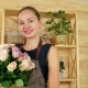 Cute Girl with a Bouquet in Hands, Florist Working in a Flower Shop, Golan Roses on the Counter for
