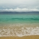 Beautiful Beach on Tropical Island in Stormy Weather