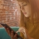 Elegant Young Woman Chatting on Touch Pad While Sitting in Comfortable Coffee Shop - VideoHive Item for Sale