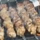 Meat Are Prepared on Metal Skewers on the Coals