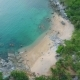 Aerial: Small Nui Beach with with Big Stones, Blue Clear Water and Green Palm Trees. Phuket - VideoHive Item for Sale