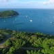 Aerial Shot of Windmill with the View on Small Paradise Island. Naiharn Beach, Phuket. - VideoHive Item for Sale