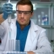 Male Scientist Conducting Research in Chemical Lab. Scientist Working in Lab