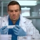Researcher in Lab. Scientist Man with Pipette in Lab. Scientist Student