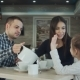 Father Pouring Tea To His Wife and Daughter in Restaurant. Mother Petting Daughter on the Head.