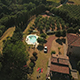 Aerial Footage of People Swimming in Pool By Holiday House - VideoHive Item for Sale