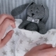 Mom Lays a Soft Toy with a Blanke