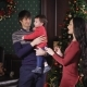 Beautiful Young Couple Is Preparing To Celebrate Christmas. Woman with Long Black Hair Wearing a
