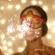 Merry Young Woman in Mask with Sparklers on Christmas Eve - VideoHive Item for Sale