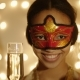 Shot of Black Woman Wearing Carnival Mask with Champagne Glass in Her Hand - VideoHive Item for Sale