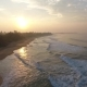 Aerial Sunset View of Tropical Beach with Fog and Yellow Sun Hikkaduwa Sri Lanka