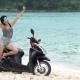 Optimistic Sexy Hippie Woman on Her Motorbike