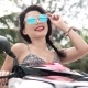 Happy Woman on Motorbike Looking To the Camera