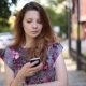 Beautiful Girl Uses Mobile Phone - VideoHive Item for Sale
