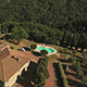 Rotating Drone Footage of Holiday House Amidst Trees - VideoHive Item for Sale
