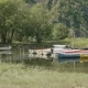 Boats, Kayaks and Canoes in the Camping. Smooth Dolly Shot - VideoHive Item for Sale