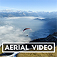 Paraglider taking of over Sea of Fog in Switzerland