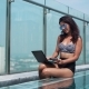 Woman Using Credit Card in the Pool on a Sunny Day