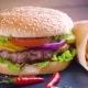 Tasty Homemade Hamburger with Potatos Served on Stone Plate