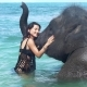 Girl with the Elephant in the Ocean