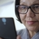 Portrait of Modern Senior Woman Using Smartphone at Home, Smiling, - VideoHive Item for Sale