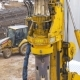Drilling Equipment Makes a Hole for the Pole, at the Construction Site.