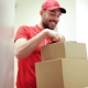Happy Man Delivering Parcel Boxes To Customer Home 45
