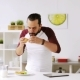 Man with Tablet Pc Eating Breakfast at Home 25