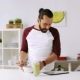 Man with Tablet Pc Eating Breakfast at Home 16