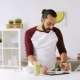 Man with Tablet Pc Eating Breakfast at Home 20