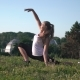 Sportswoman with Blond Long Hair Doing Stretching Workout Outdoors. - VideoHive Item for Sale