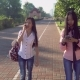 Asian Friends Walking on the Street Using Gadgets. - VideoHive Item for Sale