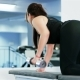 Athlete Girl Performs Exercises with Dumbbell at Hard Training in the Gym, Athletic Woman Pumping Up