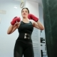Female Boxer, Self-defense Training in the Gym, Girl in Boxing Gloves for Sports, Kicking on the