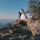 Bride and Groom on the Rocky Beach
